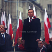 The march to celebrate the independence was attended by many ordinary polish people and also by extreme-right movements such as ONR from Poland and Forza Nuova from Italy. The motto of the march was God, Honour and Homeland. In this photo Andrzej Duda, president of Poland sing the national anthem before the start of the march